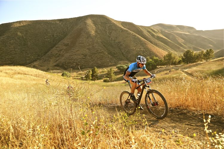 Mountain Bike Action Advertising Manager Derreck Bernard powers up a climb in the Over the Hump race series at Lake Castaic, California. Photo: John Ker/Mountain Bike Action